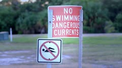 Warning Signs On A Beach Stock Footage