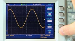 Adjusting sine wave on oscilloscope Stock Footage