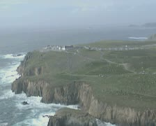 Aerial view past clifftop hotel Stock Footage