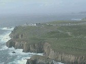 Stock Video Footage of Aerial view past clifftop hotel