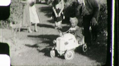 Little Girl Plays with Pedal Car Circa 1939 (Vintage Film Home Movie) 1041 Stock Footage