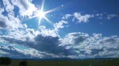 Brilliant sun in bright, blue sky. - stock footage