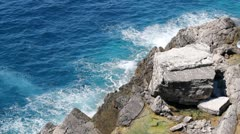 Waves Crash on Rocky Cliffs Stock Footage