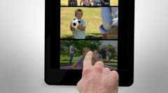 Animated tablet computer displaying videos about family leisure Stock Footage