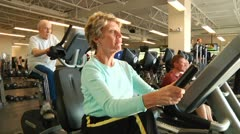 Elderly people on cardio machines Stock Footage