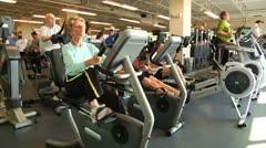 Elderly people on cardio machines 2 - stock footage