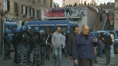 Large group of riot police near graffiti part of Rome Stock Footage
