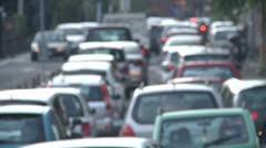 Bumper to bumper slow traffic. Defocused. - stock footage