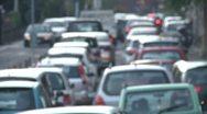 Stock Video Footage of Bumper to bumper slow traffic. Defocused.