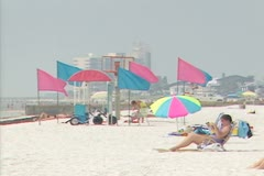 Beach view with flags and people Stock Footage