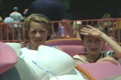 Stock Video Footage of Children riding Dumbo fairground ride