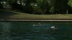 People Swim in Barton Springs - Huge Outdoor Pool Stock Footage