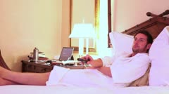 Man Relaxing on Bed in Hotel MS Stock Footage