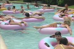 People floating in inflatable rings Stock Footage