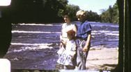 Stock Video Footage of Family Beside Wild River Vista Circa 1955 (Vintage Film Home Movie) 1066