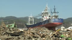 Japan Tsunami Aftermath - Large Ship Lies Amidst Burnt Wasteland Stock Footage