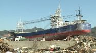 Japan Tsunami Aftermath - Large Ship Lies Amidst Burnt Wasteland Stock Footage