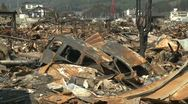Stock Video Footage of Japan Tsunami Aftermath - Wasteland Of Burnt Cars In Kesennuma City