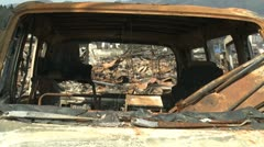 Japan Tsunami Aftermath - Remains Of Car In Burnt Wasteland Stock Footage