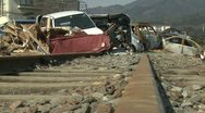 Japan Tsunami Aftermath - Wrecked Cars Block Railway Line Stock Footage