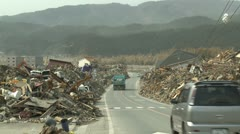 Japan Tsunami Aftermath - Debris Pilled Along Side Of Road - stock footage