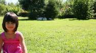 Girl on grass Stock Footage