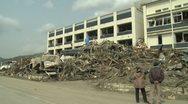 Japan Tsunami Aftermath - Destruction Outside Building Stock Footage