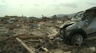 Stock Video Footage of Japan Tsunami Aftermath - Destroyed Car In Remains Of Downtown