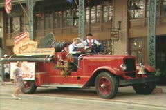 Children sitting with entertainers in old fashioned car Stock Footage