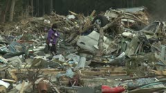Japan Tsunami Aftermath - Survivors Walk Through Destroyed Downtown Stock Footage