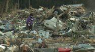 Japan Tsunami Aftermath - Survivors Walk Through Destroyed Downtown Stock Footage