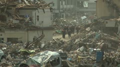 Japan Tsunami Aftermath - Rescue Crew In Remains Of Destroyed Town Stock Footage