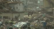 Stock Video Footage of Japan Tsunami Aftermath - Rescue Crew In Remains Of Destroyed Town