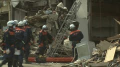Japan Tsunami Aftermath - Rescue Team Retrieve Body From Destroyed Building - stock footage