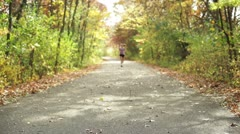 Girl jogging on trail. Stock Footage