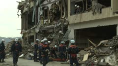 Stock Video Footage of Japan Tsunami Aftermath - Rescue Team Retrieve Body From Destroyed Building