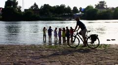 Ladenburg girls play at Neckar river canal Stock Footage