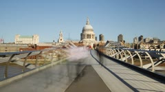Time Lapse of People Crossing Bridge with St. Paul's Cathedral, London - stock footage
