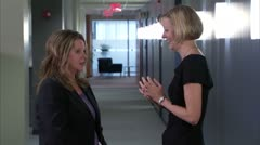 Business women talking and laughing in office Stock Footage