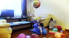 Baby boy playing, surrounded with toys Stock Footage