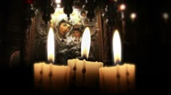 Candle in the night, close up, inside church, loop Stock Footage