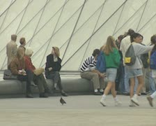 People waiting outside Louvre Pyramid Stock Footage