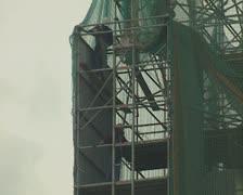Workmen on scaffolding - stock footage