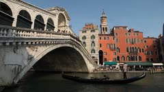 Rialto Bridge in Venice, Italy, people,  boats, ships and gondolas trip, tour Stock Footage