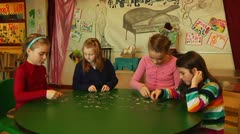 Kids building puzzle together Stock Footage