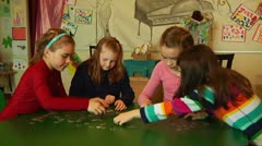 Kids playing and putting puzzle together Stock Footage