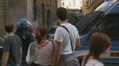 Tourists watch Rome demo behind police Stock Footage