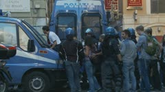 Tourists climb over riot police van Stock Footage