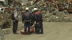 Japan Tsunami Aftermath - Man Identifies Dead Body In Rikuzentakata City - stock footage