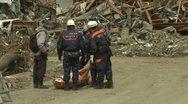 Japan Tsunami Aftermath - Man Identifies Dead Body In Rikuzentakata City Stock Footage